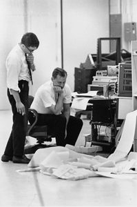 Programmers looking at print out 1960